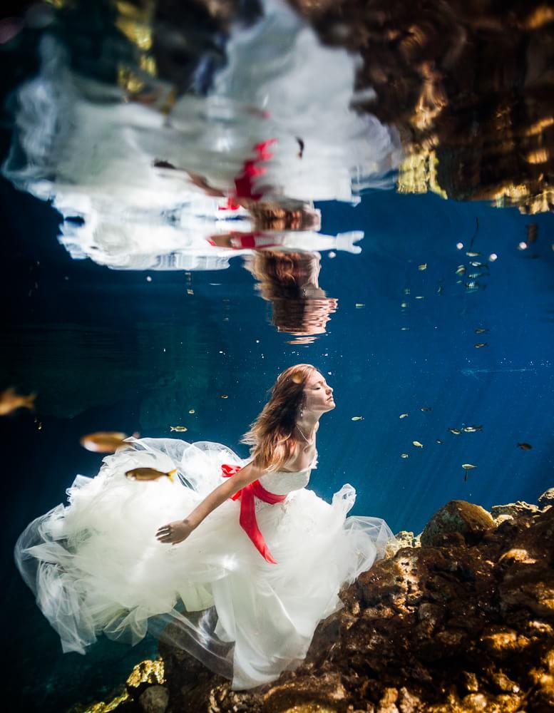 Bride in underwater Mayan Trash the dress