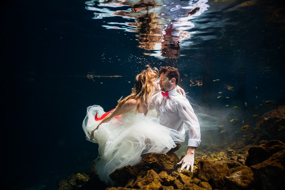Couple kissing in Mexican Cenote Trash the Dress
