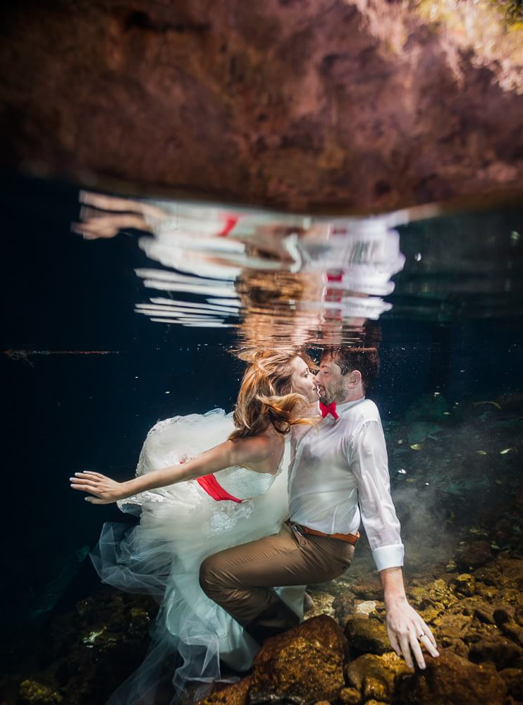 Couple in underwater wedding Trash the Dress