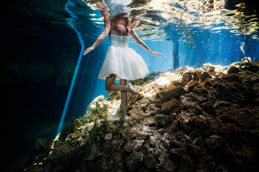 Bride underwater in Mayan Cenote Trash the dress Mexico