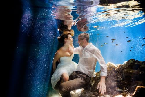 Couple underwater in Mexican Cenote in Trash the dress