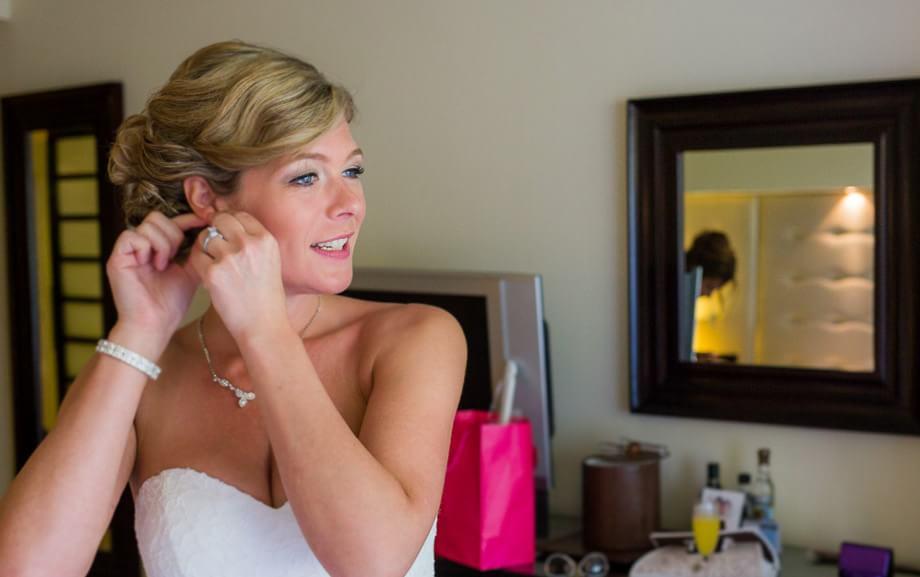 bride getting ready at grand sunset princess Riviera Maya Wedding