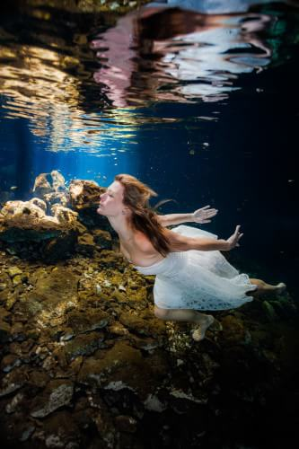 Bride in Cenote trash the dress