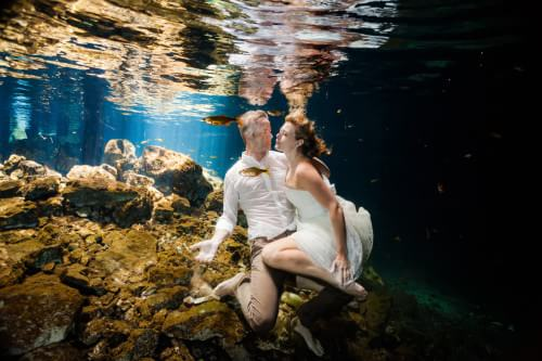 Couple underwater wedding Trash the dress in Mayan Riviera