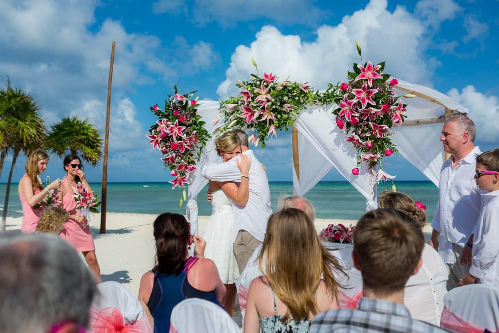 couple hugging at their Grand Sunset Princess Riviera Maya Wedding