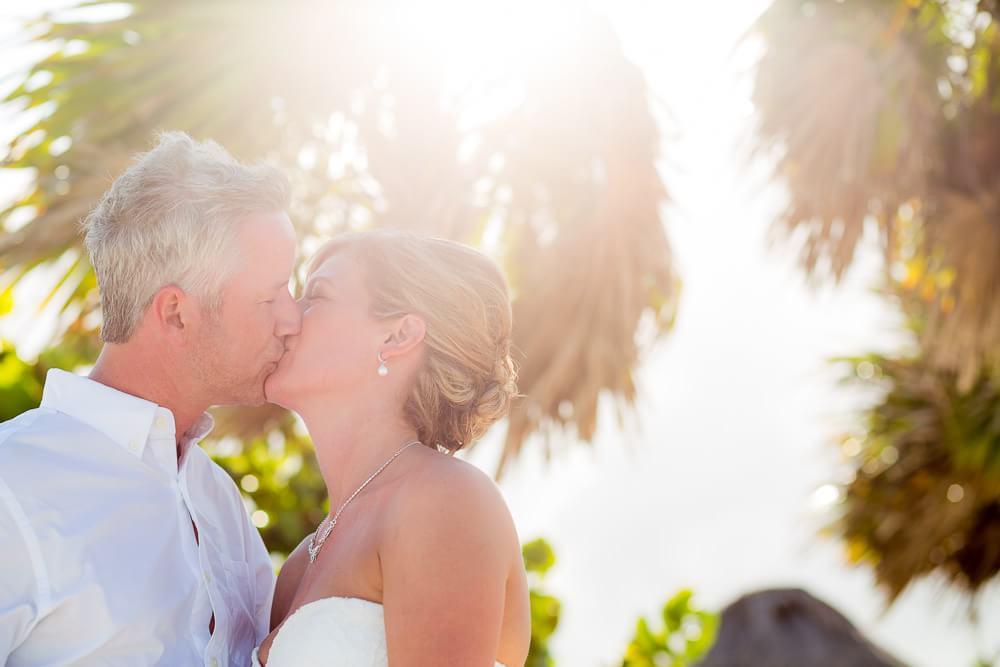 Couple kissing under tree at Grand Sunset Princess Riviera Maya Wedding