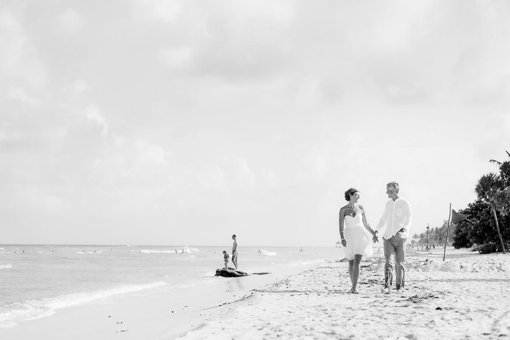 Couple walking down beach at grand sunset pincess Riviera Maya Wedding