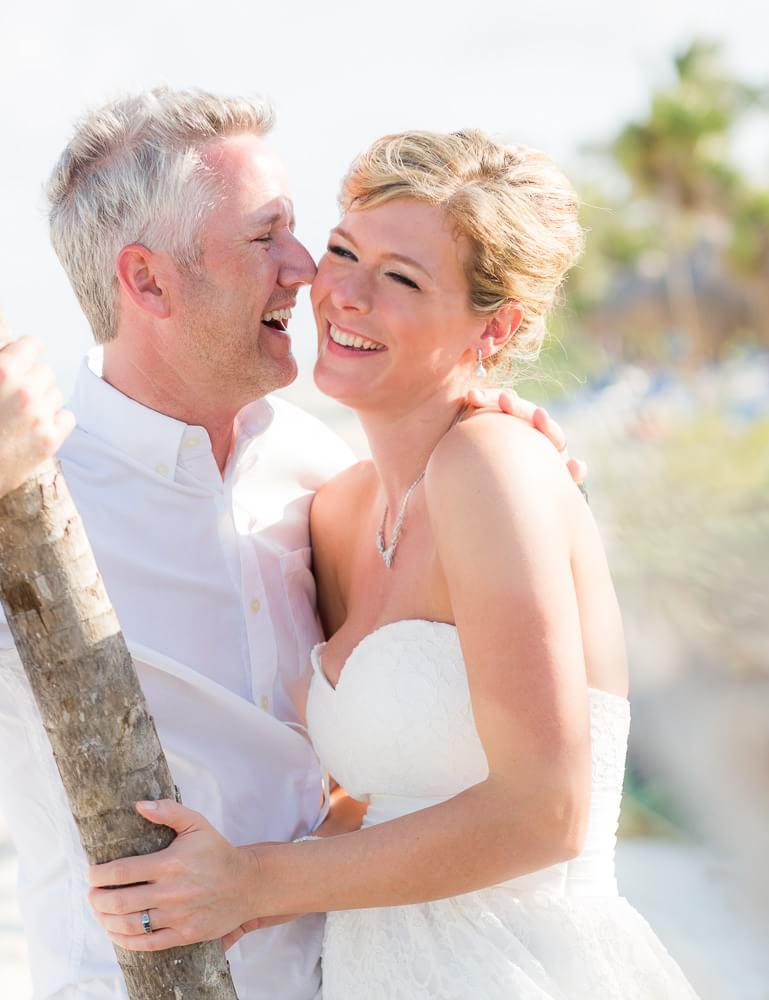 Couple laughing at Grand Sunset Princess Riviera Maya Wedding
