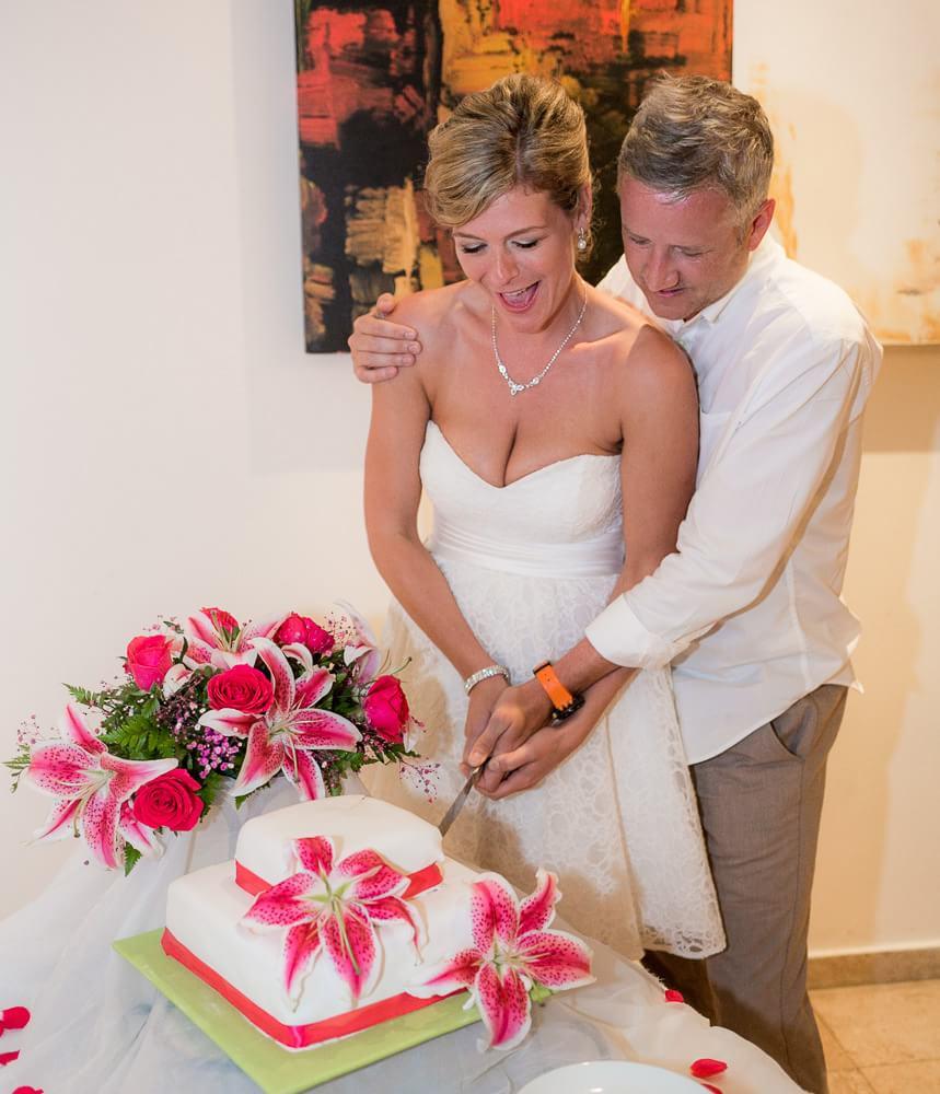 cake cutting at Grand Sunset Princess Riviera Maya Wedding