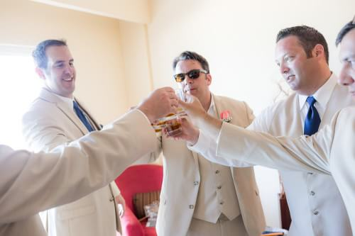 Groomsmen having a toast at Royal Playa del Carmen Wedding