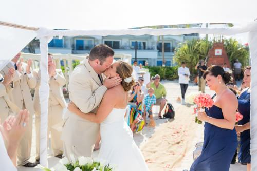 couple kissing at the beach at their Royal Playa del Carmen Wedding