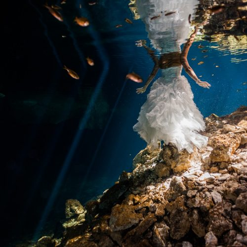 bride and dress underwater in Trash the Dress