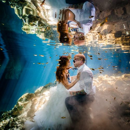 Bride and groom underwater in Mayan cenote Trash the Dress session