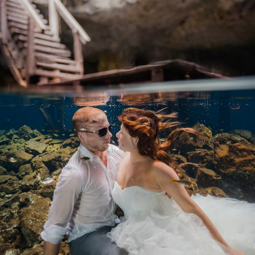 Bride and groom about to kiss underwater in Mayan cenote Trash the Dress session