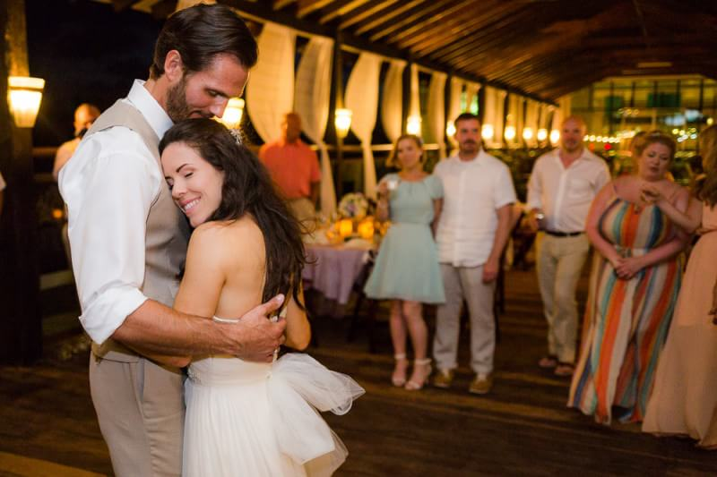 Couple hugging after first dance at generations riviera maya wedding photography