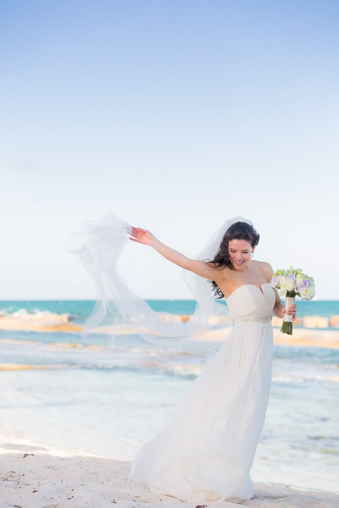 Bride on beach at generation Riviera Maya Wedding