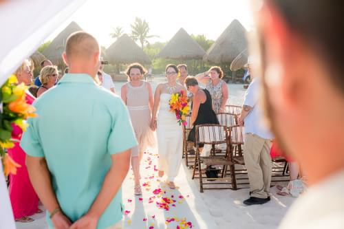 Amy walking down the aisle at her Destination Beach Wedding at Iberostar Lindo Mexico