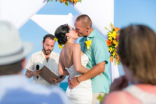 Amy and David kissing at their Destination Beach Wedding at Iberostar Lindo Mexico