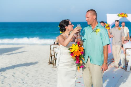 Amy and David toasting at their Destination Beach Wedding at Iberostar Lindo Mexico