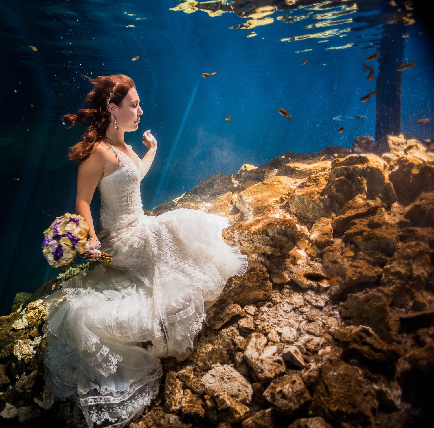 Beautiful bridal portrait in underwater trash the dress