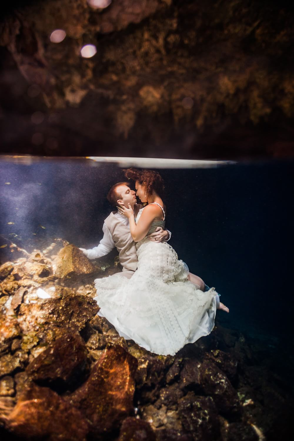 Bride and Groom in underwater trash the dress