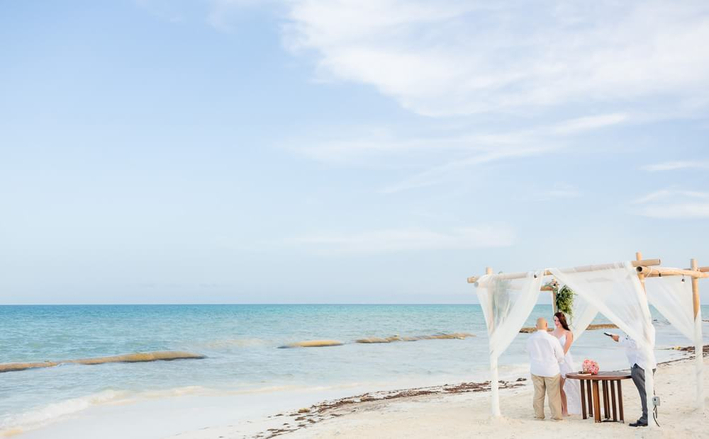 Wedding ceremony on beach at Rosewood Mayakoba Wedding