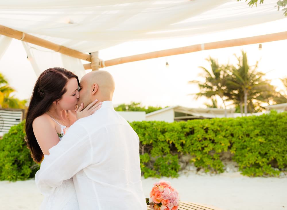 The kiss at Rosewood Mayakoba Riviera Maya Wedding