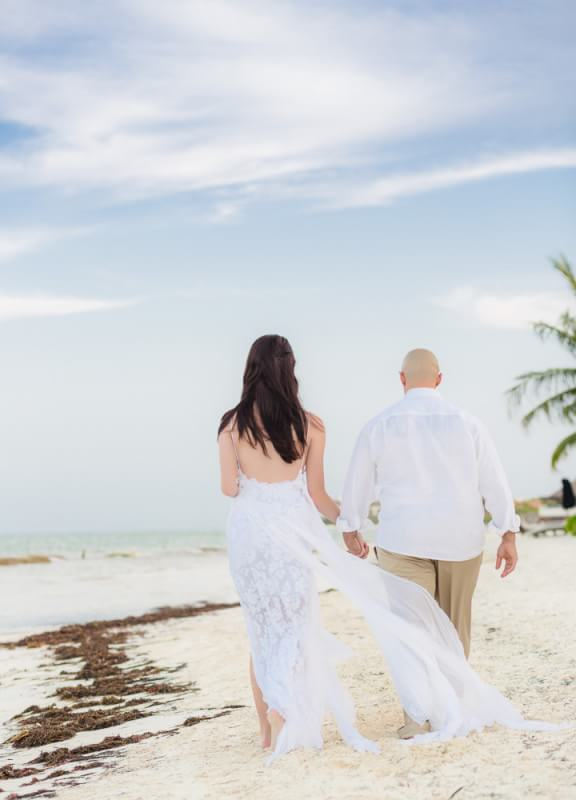 Couple walking at Rosewood Mayakoba Riveira Maya Wedding