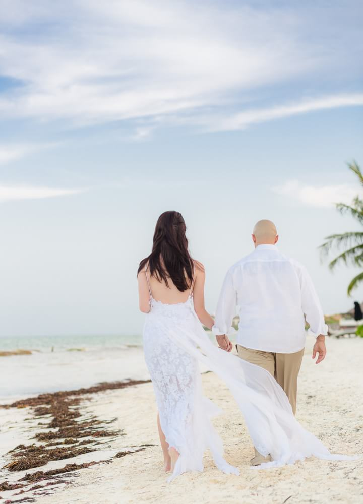 Couple walking at Rosewood Mayakoba Riveira Maya Wedding