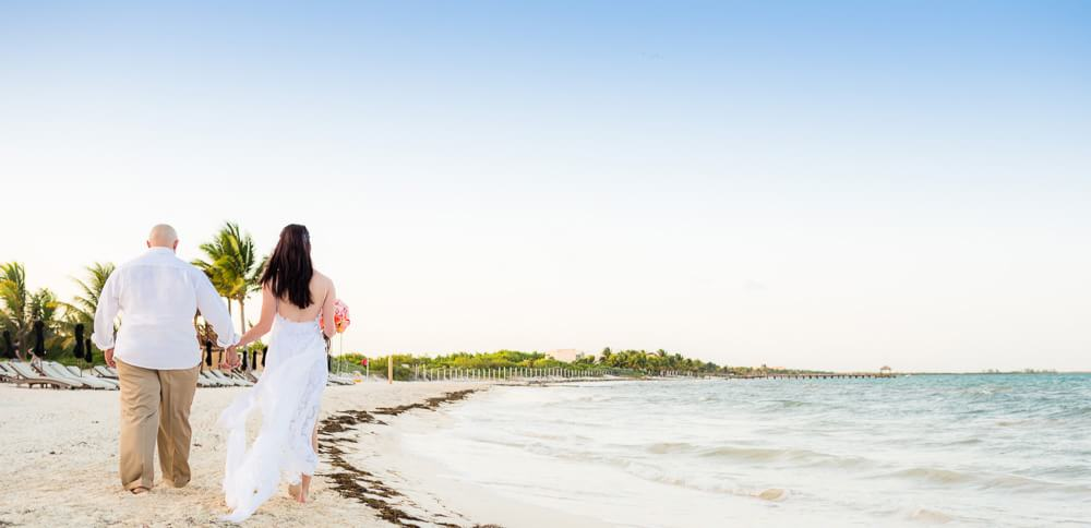 Walking on beach at Riviera Maya wedding
