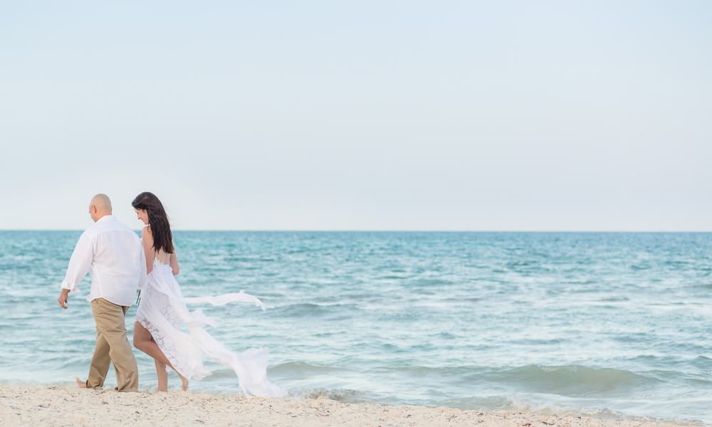 Couple walking on beach at Rosewood Mayakoba Riveira Maya Wedding