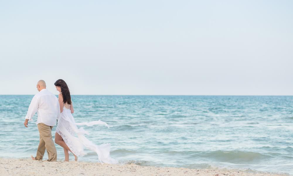 Couple walking on beach at Rosewood Mayakoba Riveira Maya Wedding