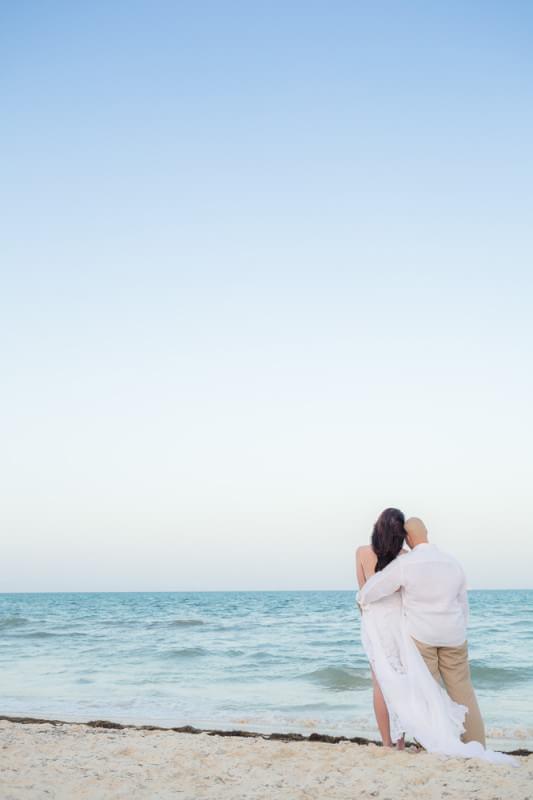 Couple looking out at ocean at Rosewood Mayakoba Riveira Maya