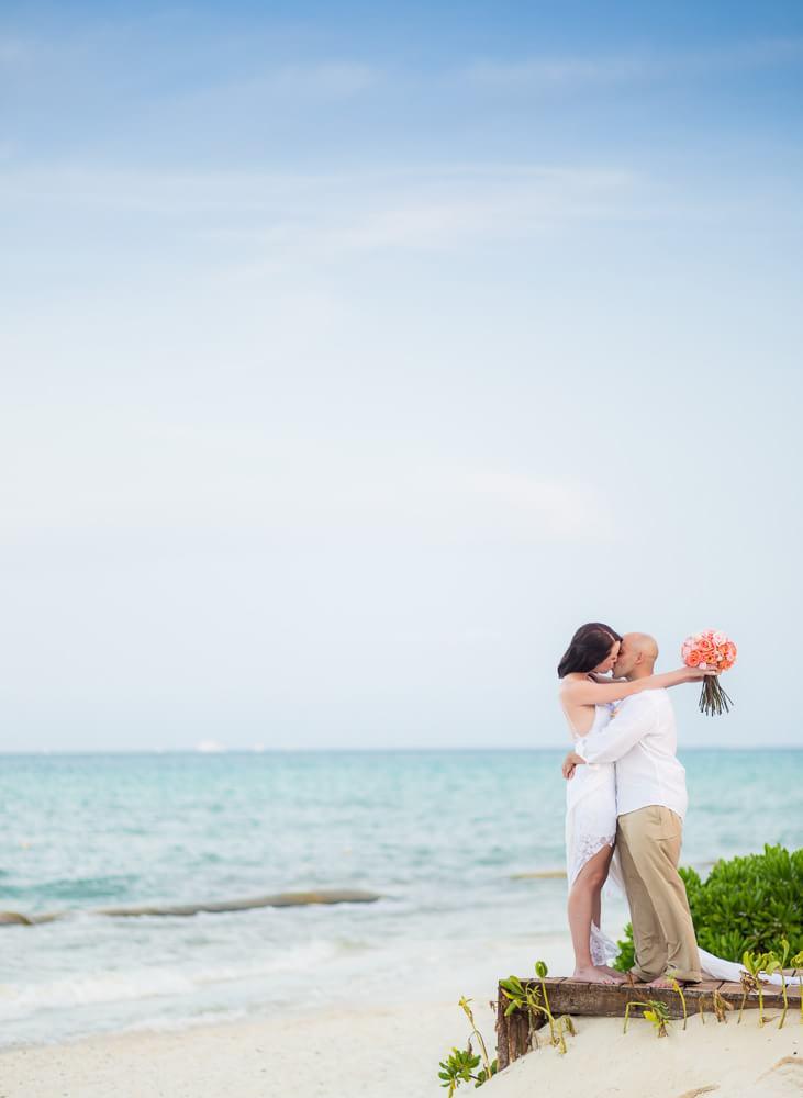 Kissing on steps of Rosewood Mayakoba Riveira Maya Wedding