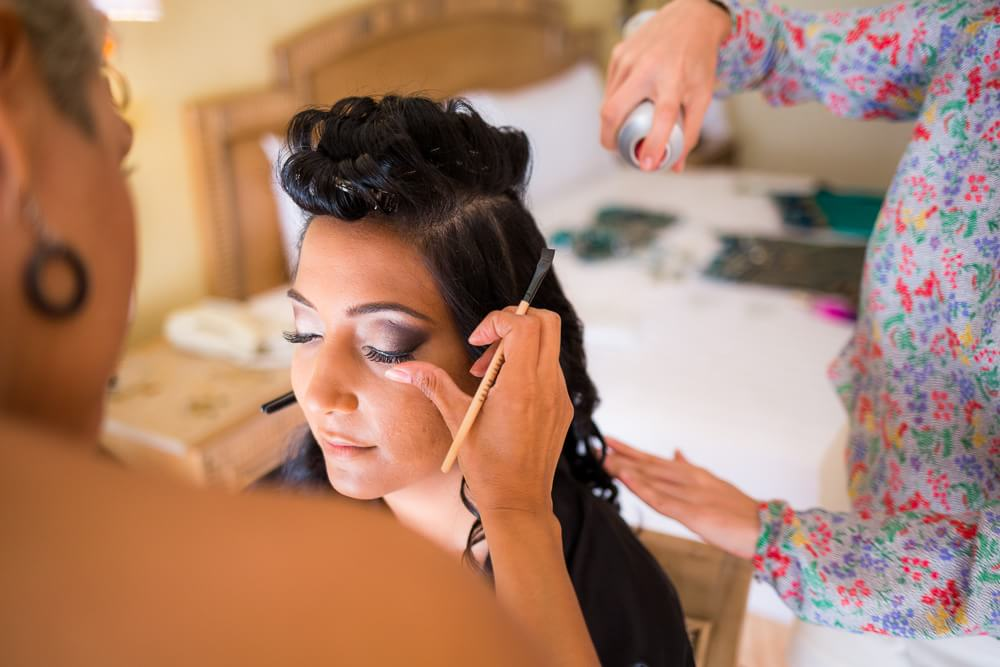 Nikita getting her make up done at her Barcelo Riviera Maya Wedding
