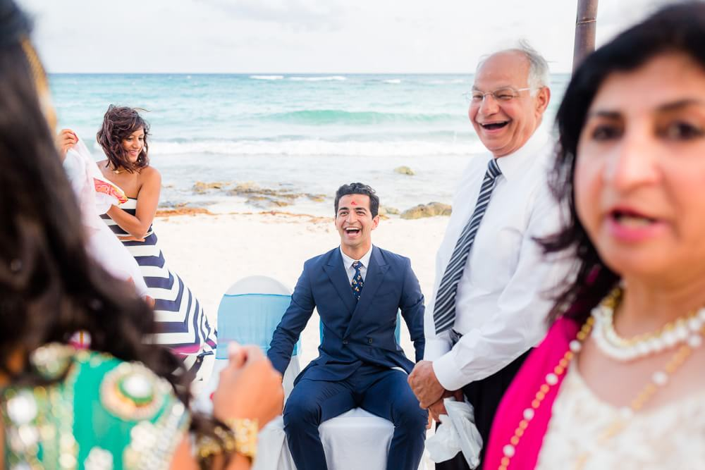 Seth having a great time at his beach wedding