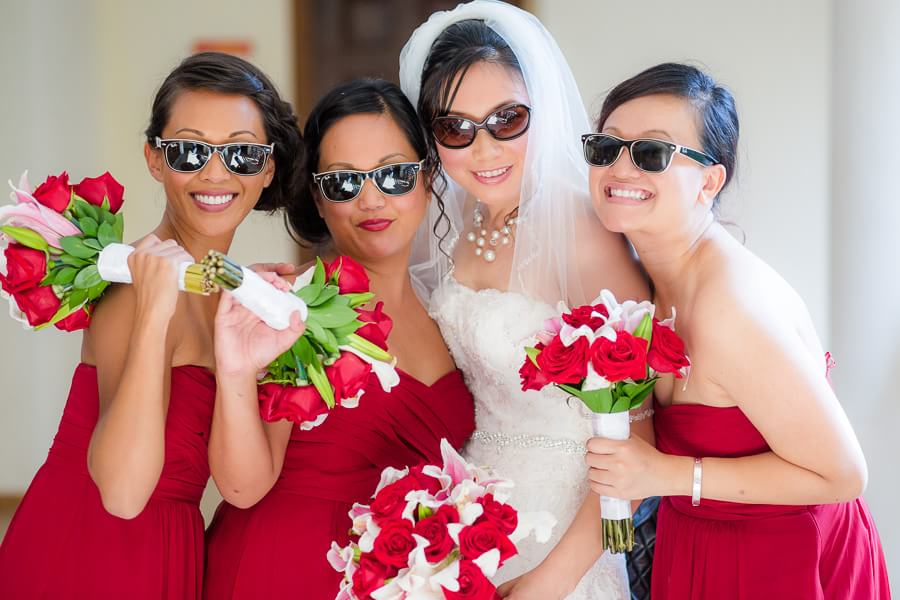 Michel and bridesmaid with cool shades at Occidental Grand Xcaret Wedding