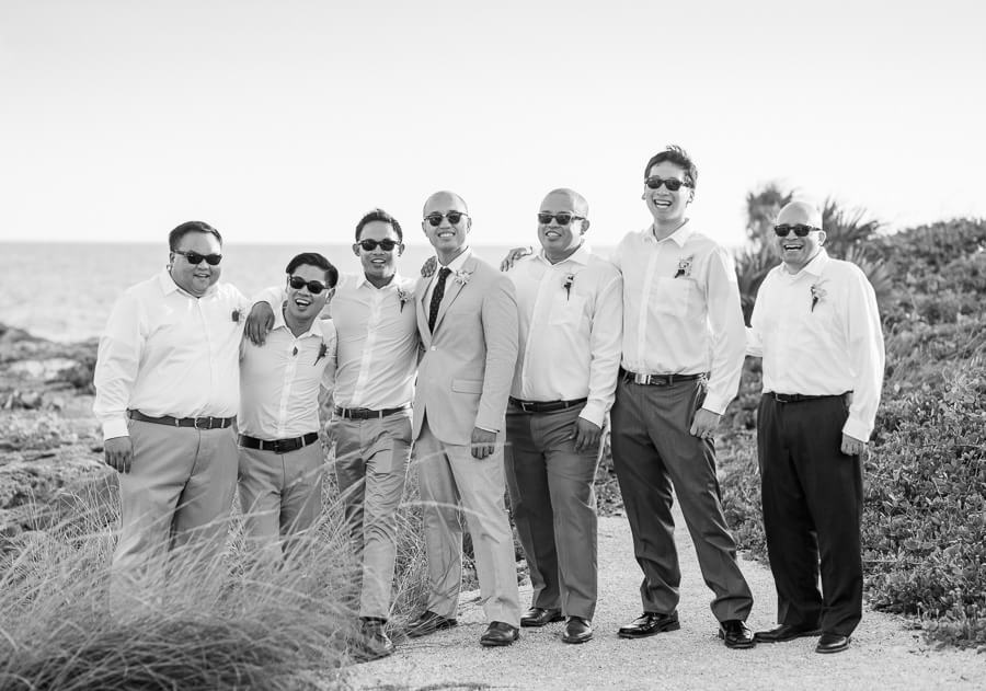Jeremy and groomsmen having fun at Occidental Grand Xcaret Wedding 122
