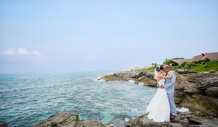 Michel and Jeremy's beautiful portrait next to the sea at Occidental Grand Xcaret Wedding 129