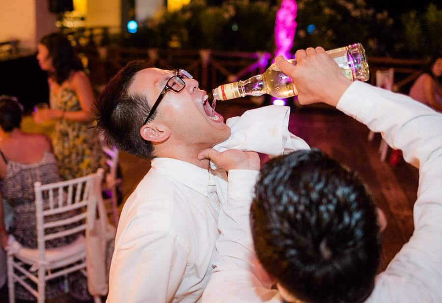 Tequila Shots at Michel and Jeremy's Occidental Grand Xcaret Wedding