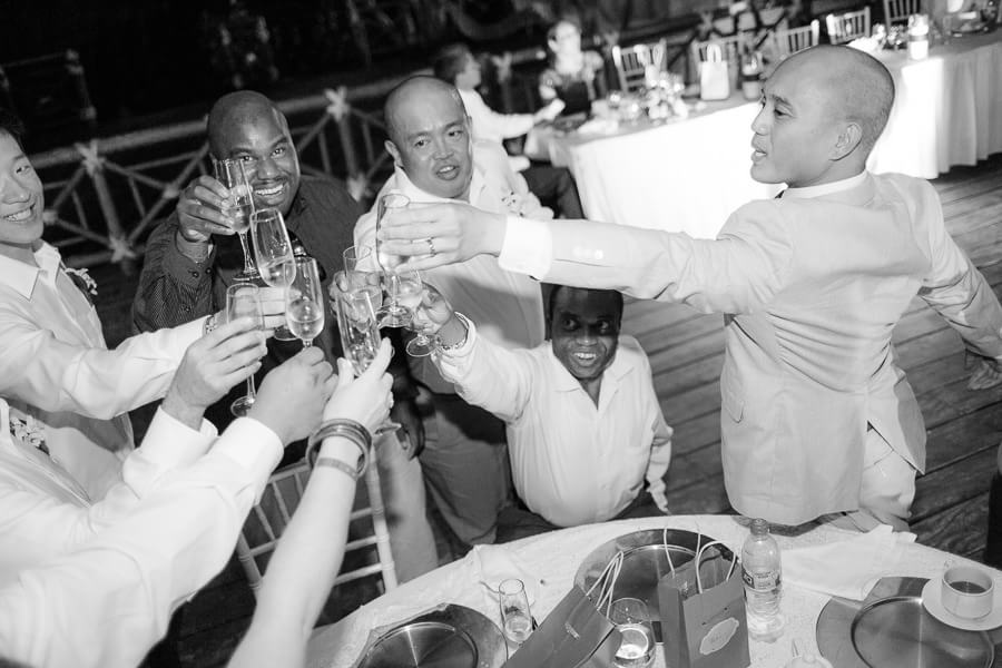 Groom toasting with friends at Occidental Grand Xcaret Wedding