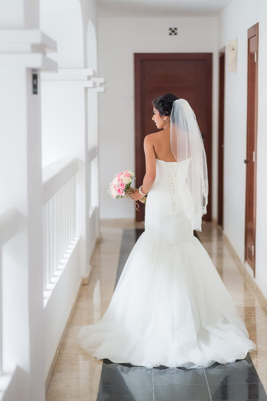 Bride walking down hallway before wedding in Riviera Maya