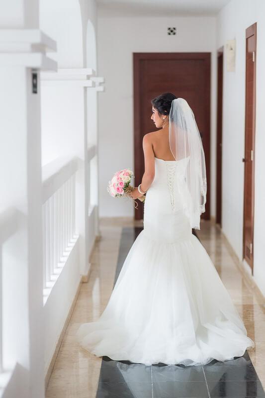 Bride walking down hallway before wedding in Riviera Maya