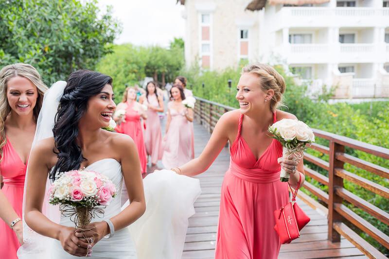 Bride and bridesmaids walking to wedding ceremony in Riviera Maya