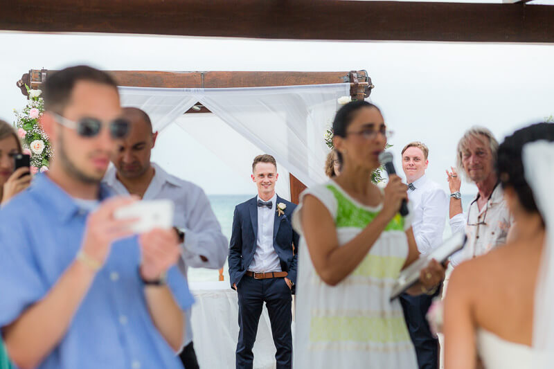 Groom watching bride walk down aisle in riviera Maya