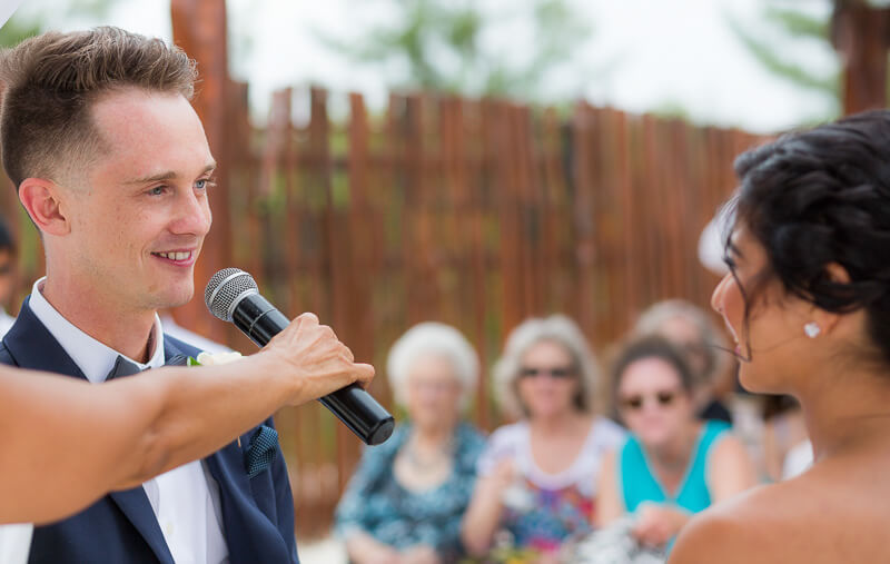 Groom saying vows at wedding in Riviera Maya
