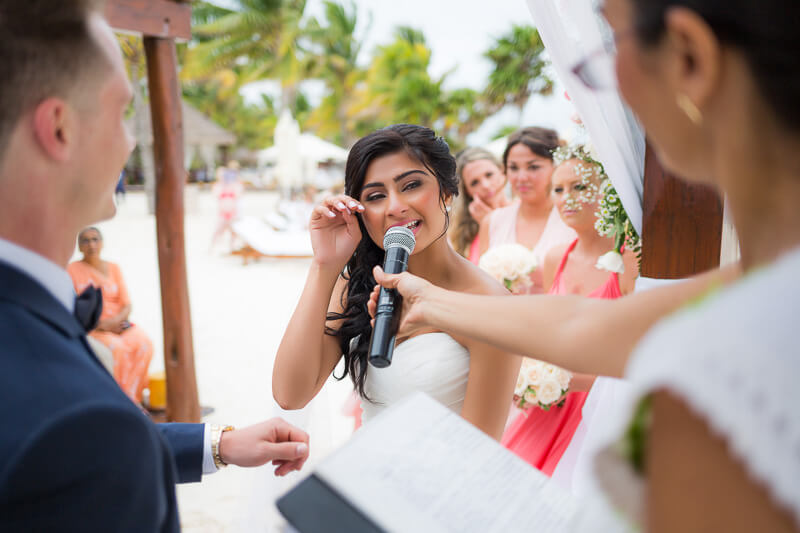 Bride crying and saying vows.