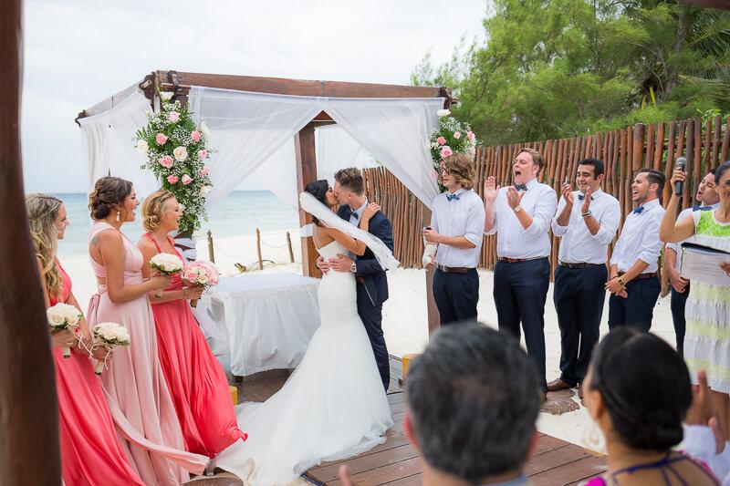 First kiss at wedding ceremony in Riviera Maya