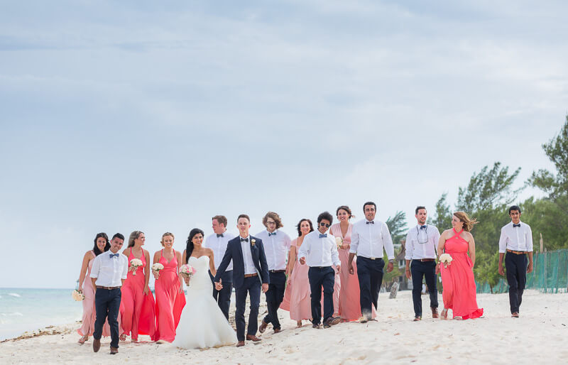 Bridal party walking on beach in Riviera Maya