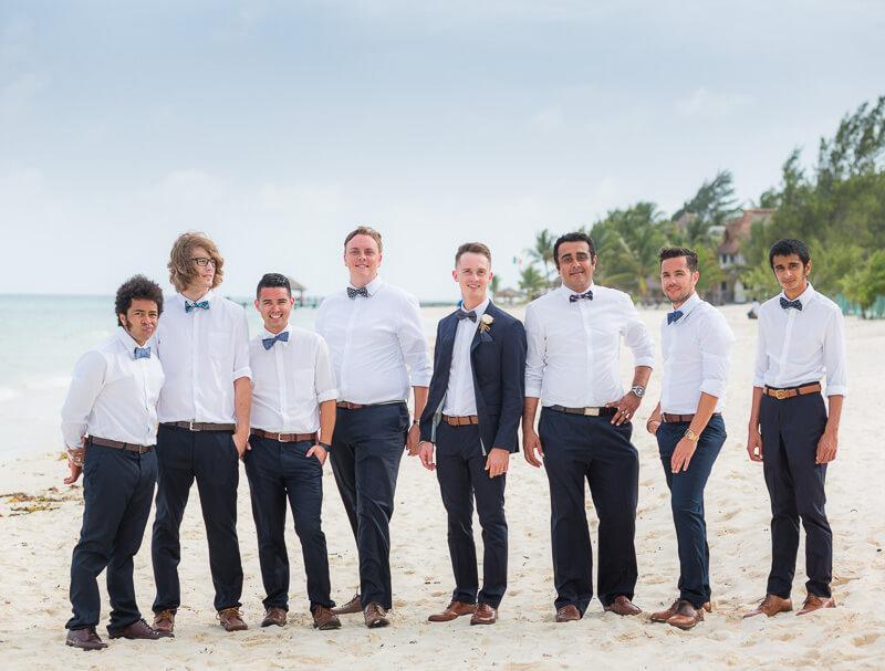 Groomsmen on beach in Riviera Maya